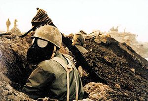 WAITING— An Iranian soldier in the 1980-88 war hunkers down in a trench awaiting an Iraqi gas attack.