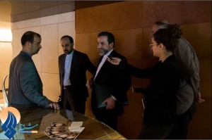 ANSWER MAN — Deputy Foreign Minister Abbas Araqchi (center) was interviewed by Israeli reporters who intercepted him in a Geneva hotel.  The daily Mashreq said Araqchi didn't know who they were.  But notice the aide (second from left) tugging at Araqchi's sleeve to get him to move on.