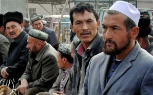 CHINA — Uighurs gather at a bazaar.  Iran has been silent about efforts by the Chinese government to suppress the practice of the Ramadan fast.