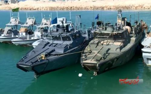 LOCKED IN DOCK — The two US Navy riverine boats were photographed while docked at Farsi Island between Pasdar vessels.  The US Navy boats are each 49-feet long (15 meters) and carry three .50 caliber machine guns.