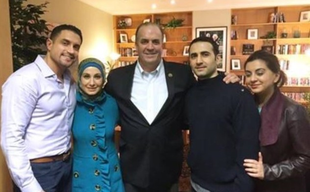 FILLING UP ON STEAK — Decompressing at the same base is Amir Hekmati (second from right), seen here with, from right, his sister Leila, his congressman, Dan Kildee, another sister, Sarah, and her husband, Ramy Kurdi.