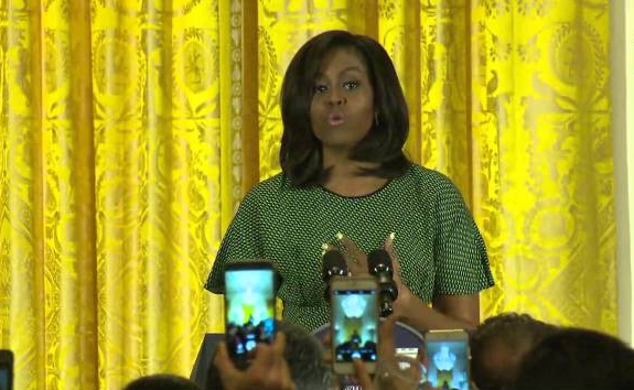 NOW HEAR THIS — The cellphone cameras went up as First Lady Michelle Obama spoke to the White House Now Ruz celebrants.