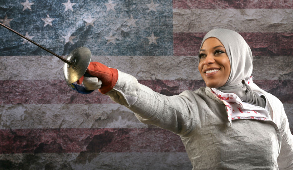 ARMORED — Ibtihaj Muhammad is an African-American Muslim on the US Olympic team.  She was encouraged to take up fencing because it is one sport that requires participants to be well-covered—armored, in fact.  When she competes, she must also wear a facemask as protection.