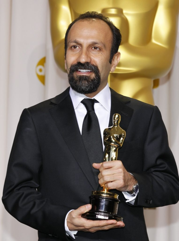 """LOOKING FOR A MATCHED PAIR — Asghar Farhadi poses with the Oscar he received for """"The Separation."""""""