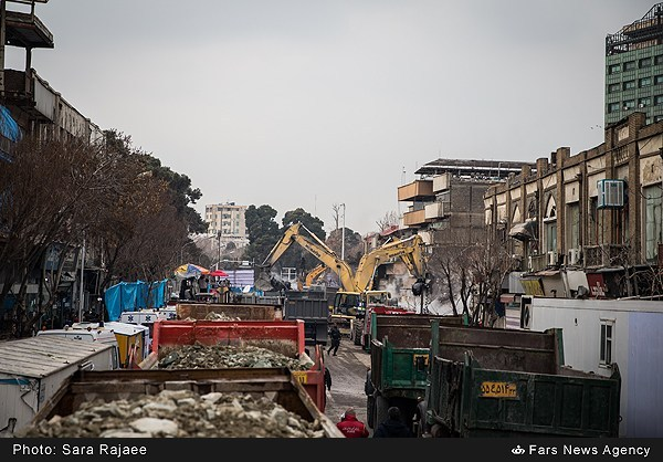 FROM TOWER TO EMPTY SITE — A huge fleet of dump trucks had to be mobilized to cart away the remains of the 17-story Plasco building.  After nine days of work, the site has now been cleared. It hasn't been decided what will be built on the site next.